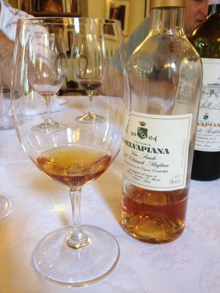 a sip of vinsanto at the end of the meal