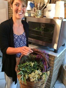 Elke with a basket of herbs