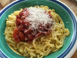 pasta alla chitarra with tomato-pepper sauce and grated parmigiano